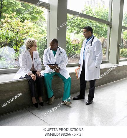 Doctors talking together in lobby