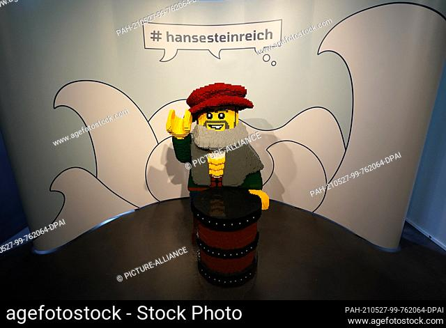 25 May 2021, Schleswig-Holstein, Lübeck: The Lego figure shows the Hanseatic merchant Winni Warendorp. The figure consists of around 70