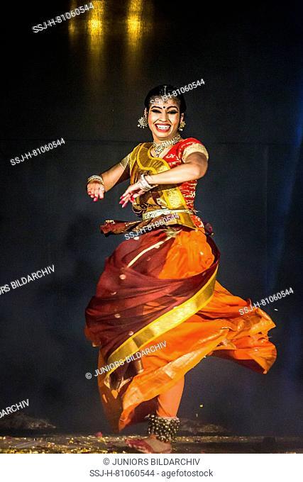 Dancer at Holika Dahan celebration. Udaipur, Rajasthan, India
