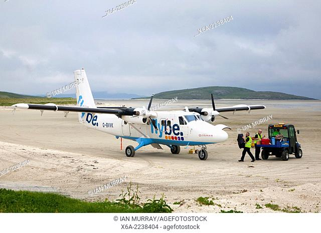 Flybe plane on sandy airstrip Isle of Barra airport, Outer Hebrides, Scotland