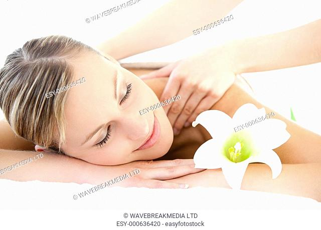 Relaxed woman receiving a back massage in a Spa center