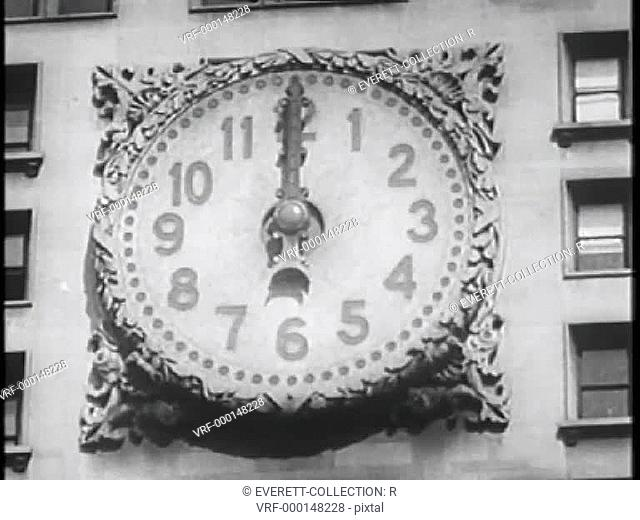 Close-up of large clock on side of building