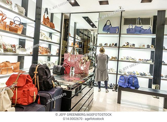 Argentina, Buenos Aires, Abasto Shopping Mall, Blaque, store, shoes, handbags, store, woman, looking, interior, Hispanic