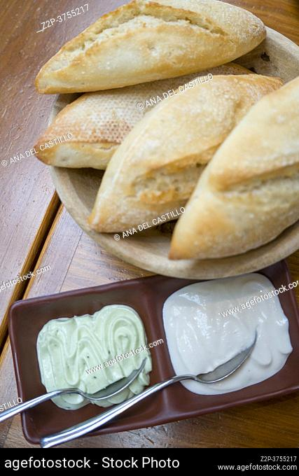 Loaves of crunchy bread and allioli sauces Spanish appetizer