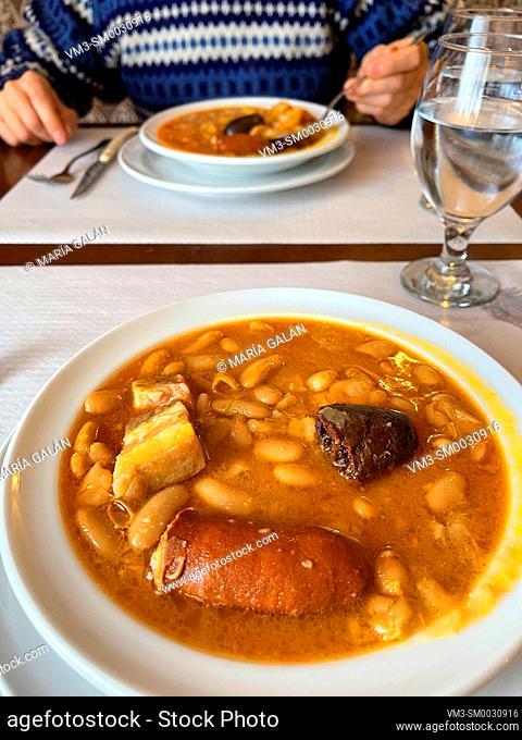 Eating fabada asturiana. Asturias, Spain