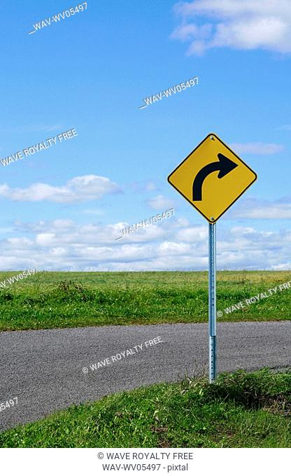 Curve ahead sign on country road
