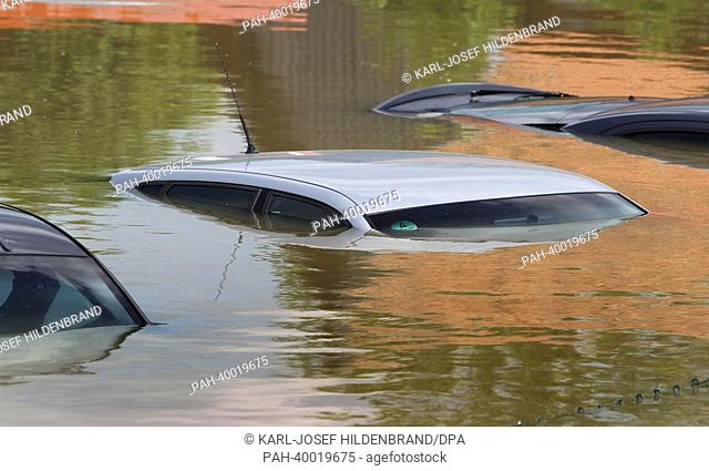 Car roofs stick out of the water in the flooded Deggendorf, Germany, 05 June 2013. Photo: KARL-JOSEF HILDENBRAND | usage worldwide