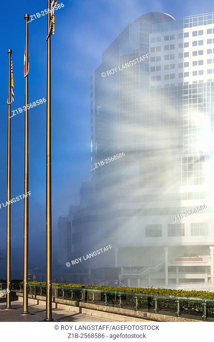 Sun rays in fog reflected off a hotel window