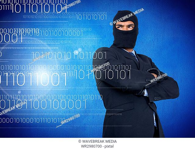 Hacker with hood and arms crossed standing on in front of blue background