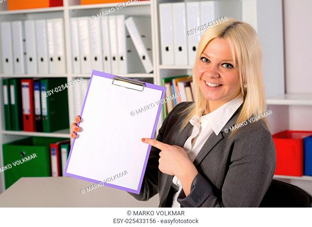 smiling blond young business woman with a clipboard