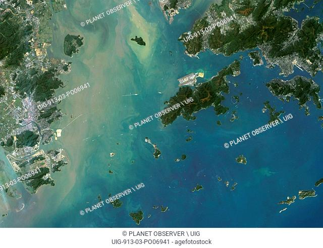 Satellite view of Hong Kong and Macau. The Hong Kong–Zhuhai–Macau Bridge which consists of a series of bridges and tunnels can be seen on the image