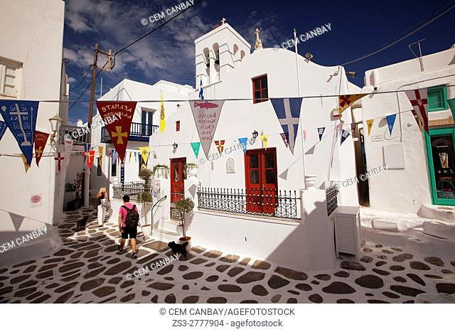 People in front of the red domed church in town center, Mykonos, Cyclades Islands, Greek Islands, Greece, Europe