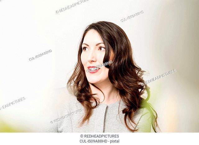 Portrait of brunette woman looking away