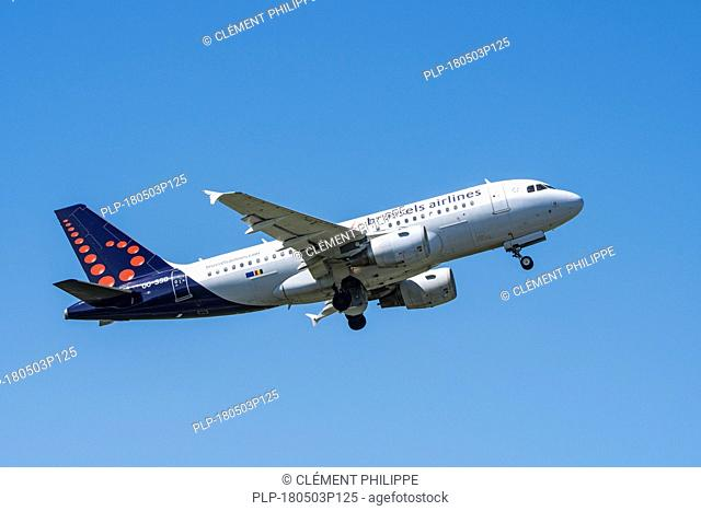 Airbus A319-111, narrow-body, commercial passenger twin-engine jet airliner from Belgian Brussels Airlines in flight against blue sky