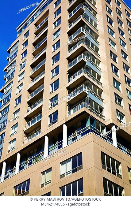Modern glass, steel and concrete residential condominium building, Montreal, Quebec, Canada