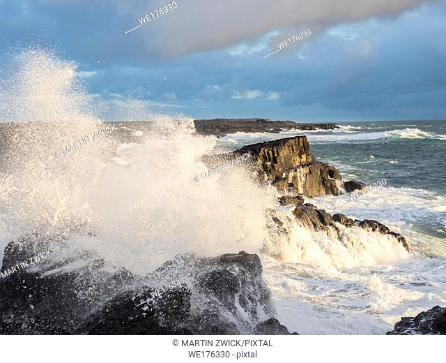 Coastline at Brimketill during stormy conditions at sunset. The coast of the north atlantic on Reykjanes peninsula during winter