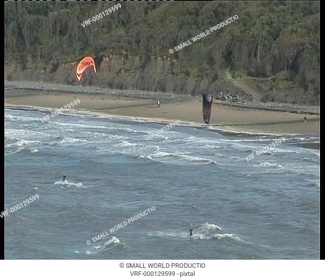 Kite surfers near coast, Newquay, West Wales