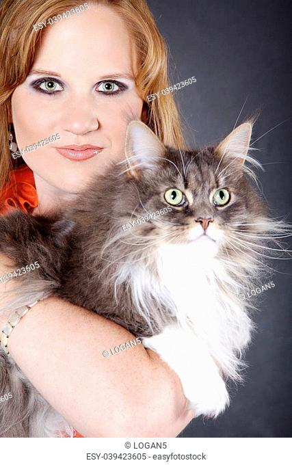 Woman with maine coon cat