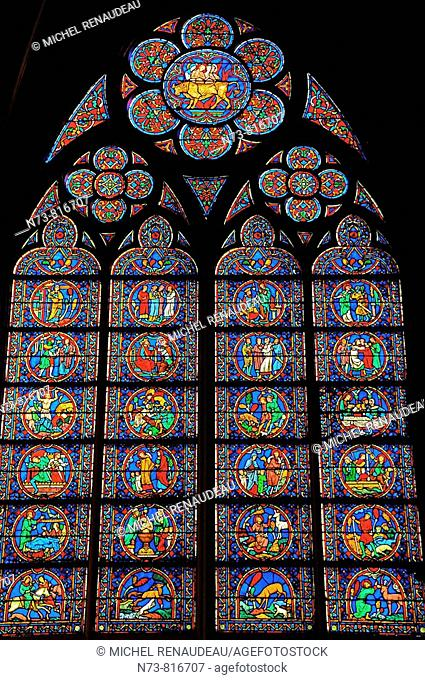 Stained glass windows in a South side chapel of Notre Dame cathedral, Paris, France