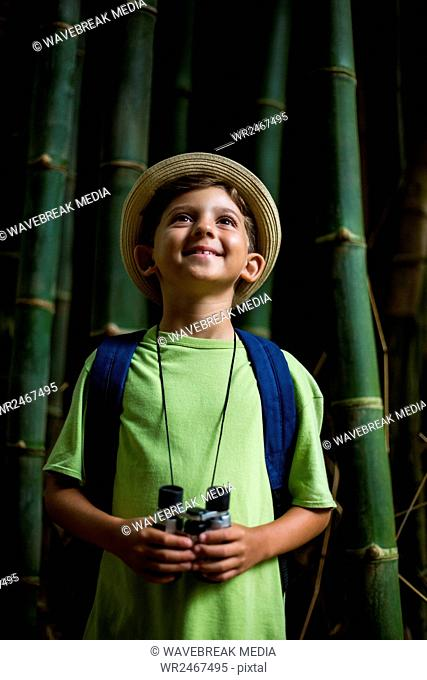 Boy standing in forest