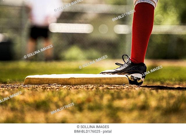 Baseball player touching base