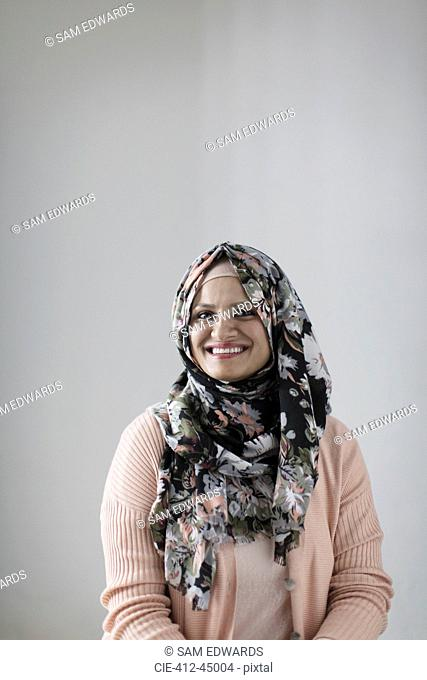 Portrait smiling, confident woman wearing floral hijab