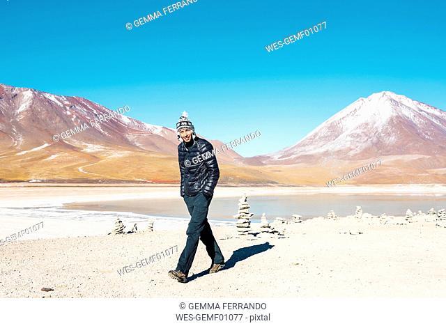 Bolivia, Eduardo Avaroa Andean Fauna National Reserve, Man wearing chullo, walking at Laguna Verde