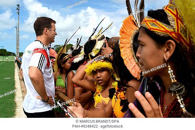 A group of Brazilian indigenous talks to German team manager Oliver Bierhoff during an open training session for fans and spectators of the German national...