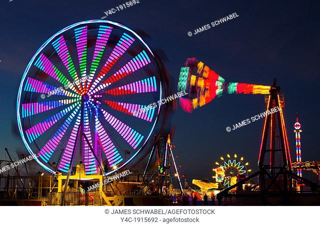 Carnival rides at night showing blurred motion at Irish Feast in Venice Florida