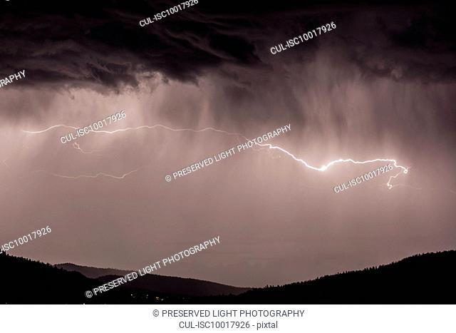 Lightning bolts during thunderstorm over Okanagan Valley, British Columbia, Canada