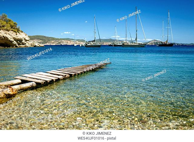 Spain, Ibiza, Jetty in bay with sailing boats
