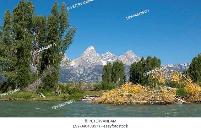 Scenic view of Grand Tetons mountain range from Snake River in Grand Teton National Park, WY