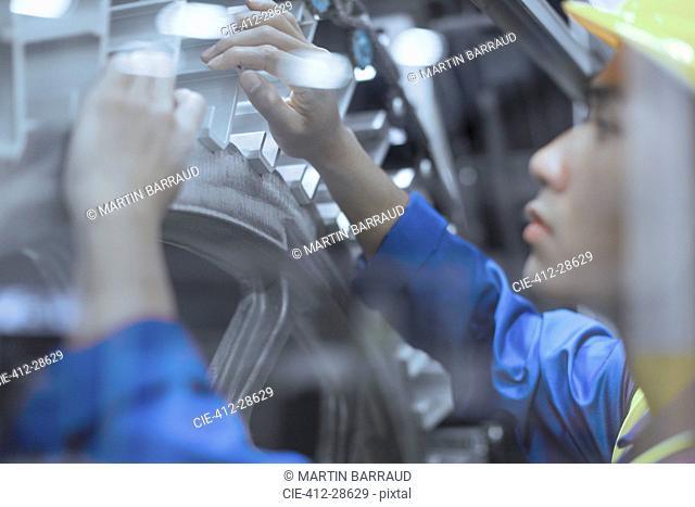 Engineer repairing machinery in factory