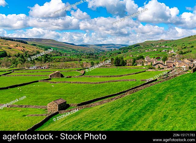Gunnerside, North Yorkshire, England, UK - May 21, 2019: Swaledale landscape, looking towards the village of Gunnerside
