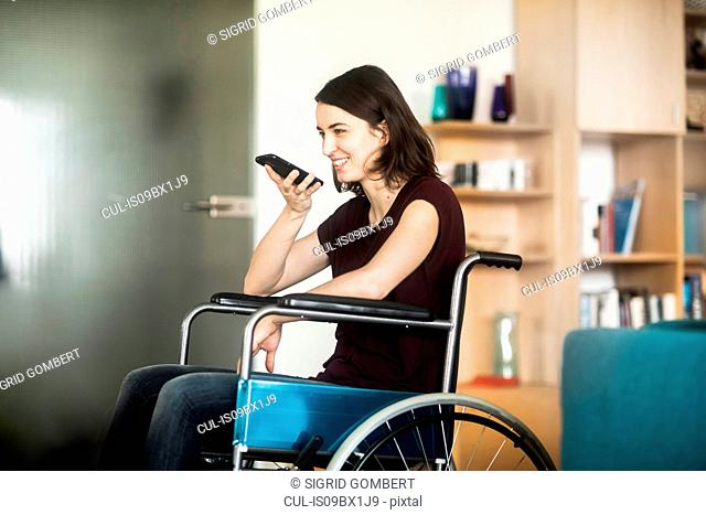 Woman in wheelchair using cellphone