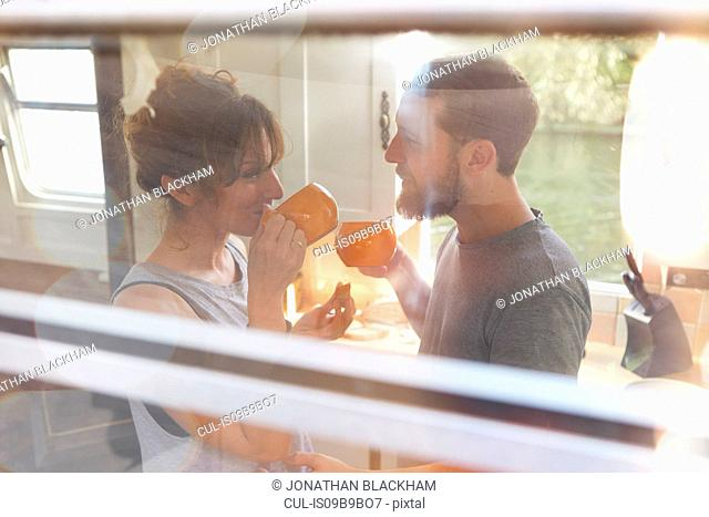 Couple having breakfast in canal boat