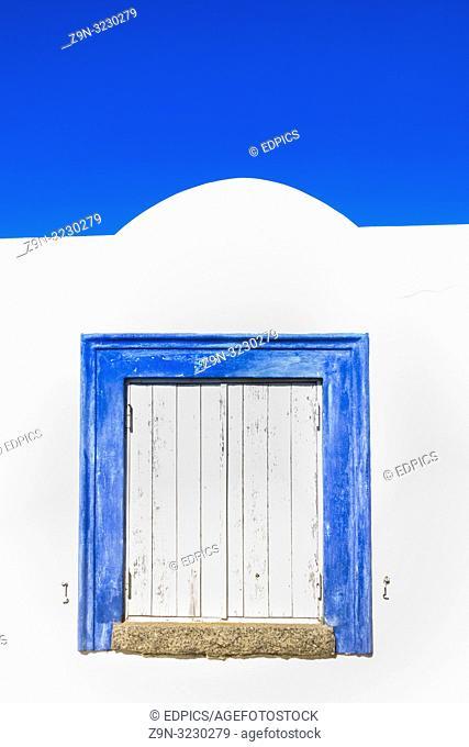historic algarve architecture building with blue framed window, praia da rocha, portimao, algarve, portugal