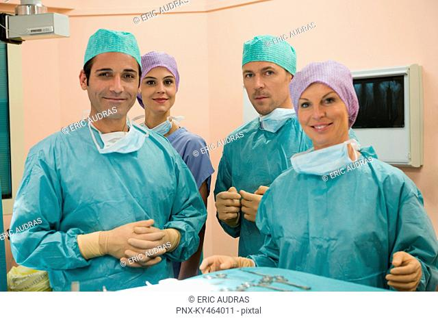 Medical team smiling in an operating room