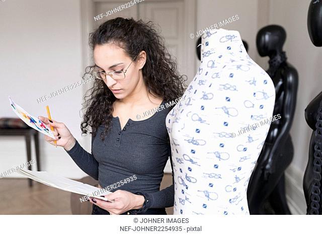 Designer looks at sketch