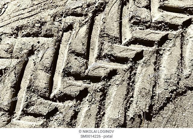 Diagonal tire footprint in dirt texture background hd