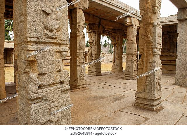 Carved pillars of at the entrance of the maha-mandapa, Achyuta Raya temple, Hampi, Karnataka, India. Sacred Center. View from the north-west