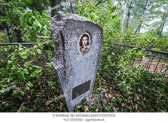 Grave on cemetery in Pripyat ghost city of Chernobyl Nuclear Power Plant Zone of Alienation around nuclear reactor disaster in Ukraine