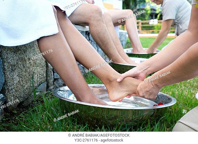 People receiving a wellness foot bath