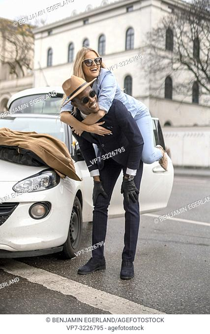 Man giving his girlfriend a piggyback ride. Munich, Germany