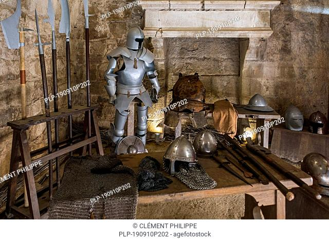 Suit of armour, halberds and weapons of the Middle Ages in armoury at the Château de Tiffauges, medieval castle, Vendée, France
