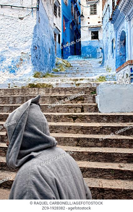Man walking on the blue streets of the medina, Chefchaouen, Rif region, Morocco