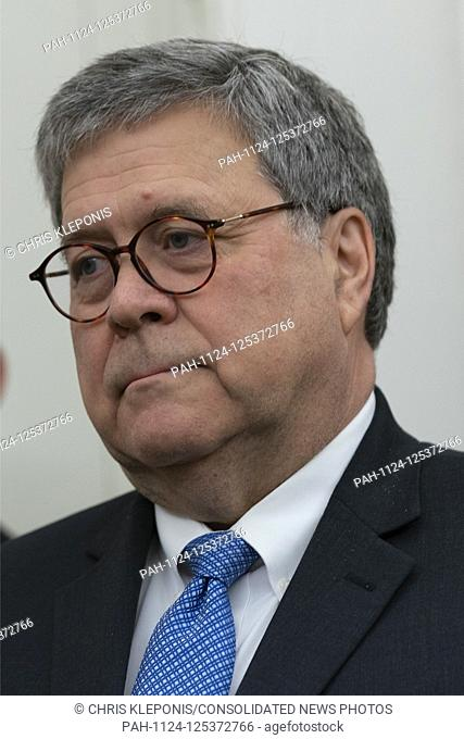 United States Attorney General William P. Barr listens as US President Donald J. Trump presents the Presidential Medal of Freedom to former US Attorney General...