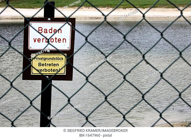 Two signs Baden verboten and Privatgrundstueck, Betreten verboten, German for Bathing prohibited and Private property, keep off, prohibition signs on the beach