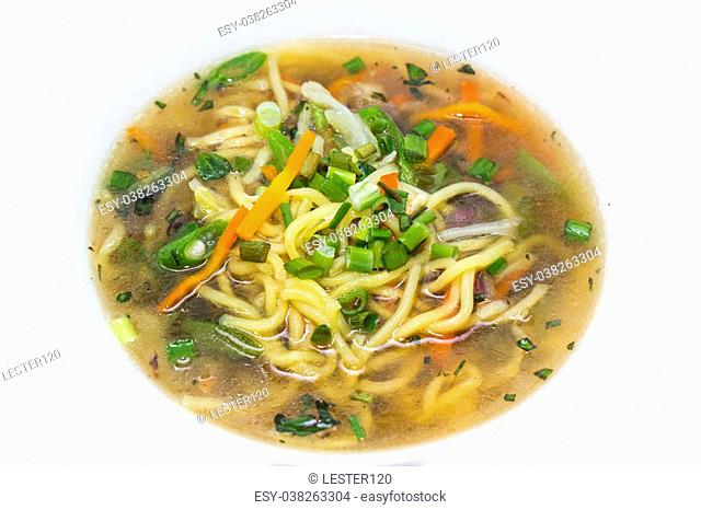 soup with meat and pasta on a white background in the restaurant