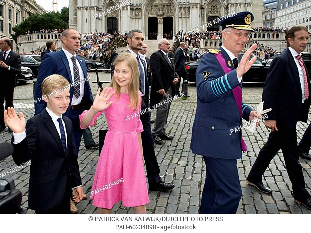 Prince Emmanuel (L-R), Crown Princess Elisabeth and King Philippe of Belgium greet well-wishers after the Te Deum mass at the Cathedral of St